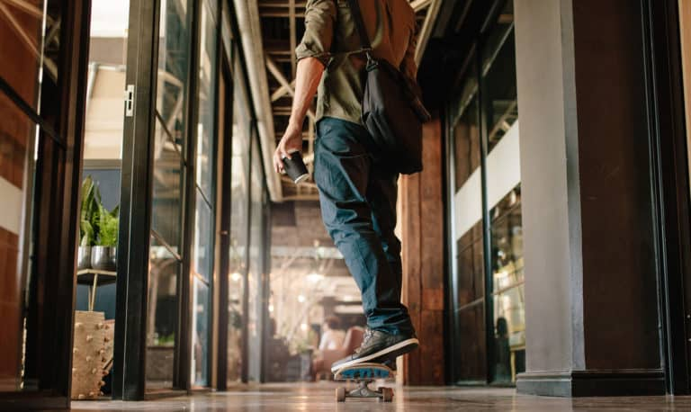 Male employee skateboarding in the workplace