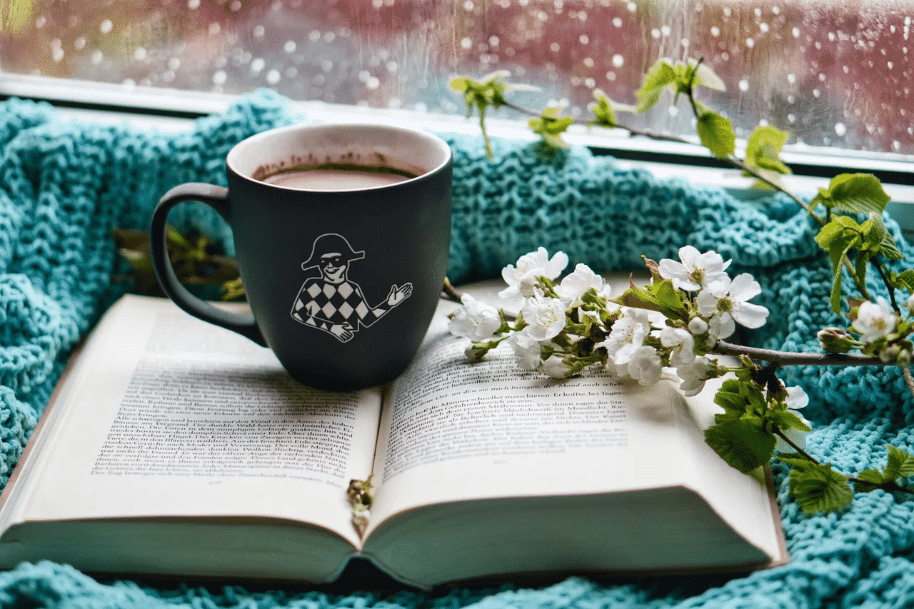 coffee, book, and flower at home